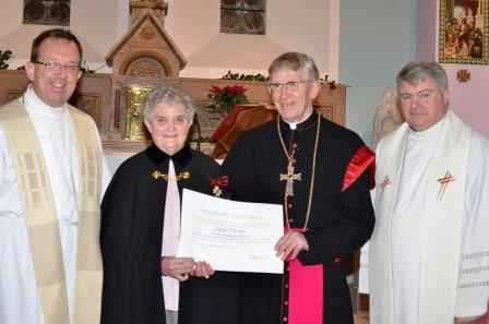 Sheila O'Leary who became a Dame of the Order of St Sylvester for her over 40 years of service as sacristan in St Finbarr's oratory Gougane Barra. Bishop John Buckley Bishop of Cork and Ross presented what is one of the high awards for people for their service to the church on behalf of Pope Francis. Rev Dr Tom Deenihan Diocesan Secretary is pictured left and Fr Martin O'Driscoll PP Uibh Laoire parish is right of picture (Photo: Catherine Ketch)